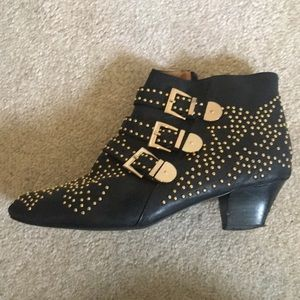 Black, gold studded leather ankle booties.